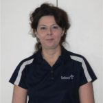 Select Cleaning business owner Michelle in Auckland wearing Select Cleaning uniform