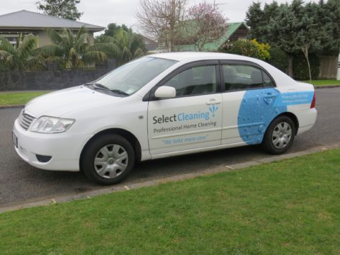 Vehicle signage on car of Select Cleaning franchisee in Auckland